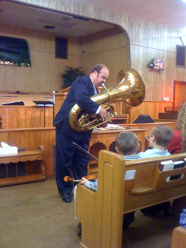 Pastor White entertains the Duggar children before the service